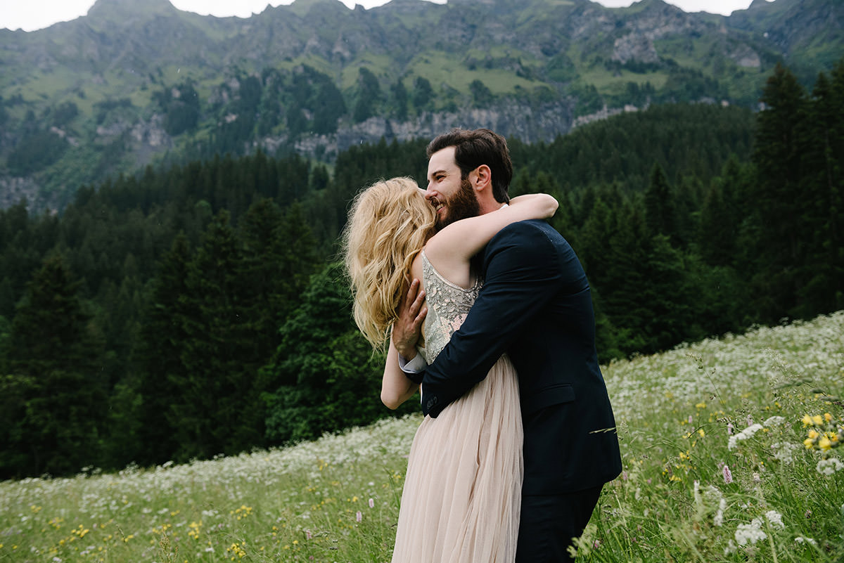 how to choose a wedding photographer couple embracing in the mountains at Wengen