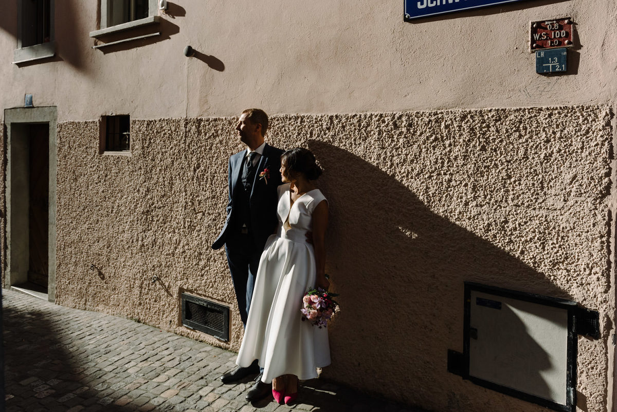 sunny old town in Zurich couple before their wedding Peggy Hartanto dress