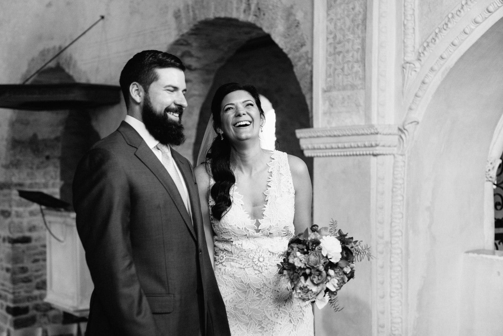 elopement ceremony at Schloss Spiez, bride wears a Lazaro Dress