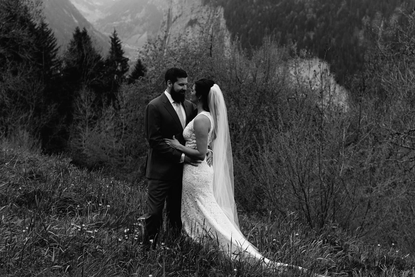 couple portrait mountain elopement at staubbach falls in Switzerland