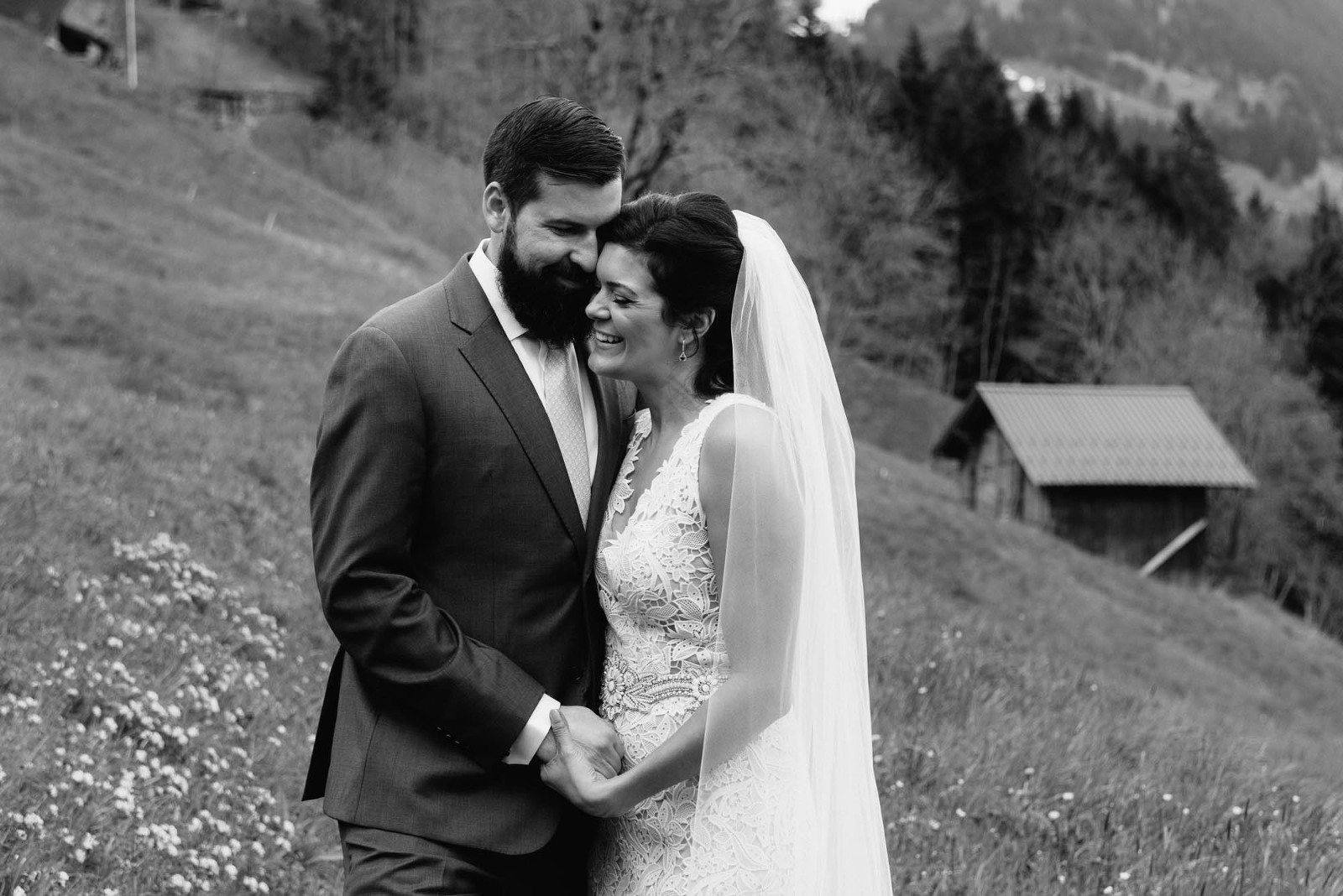 smiling couple of their mountain elopement in Switzerland