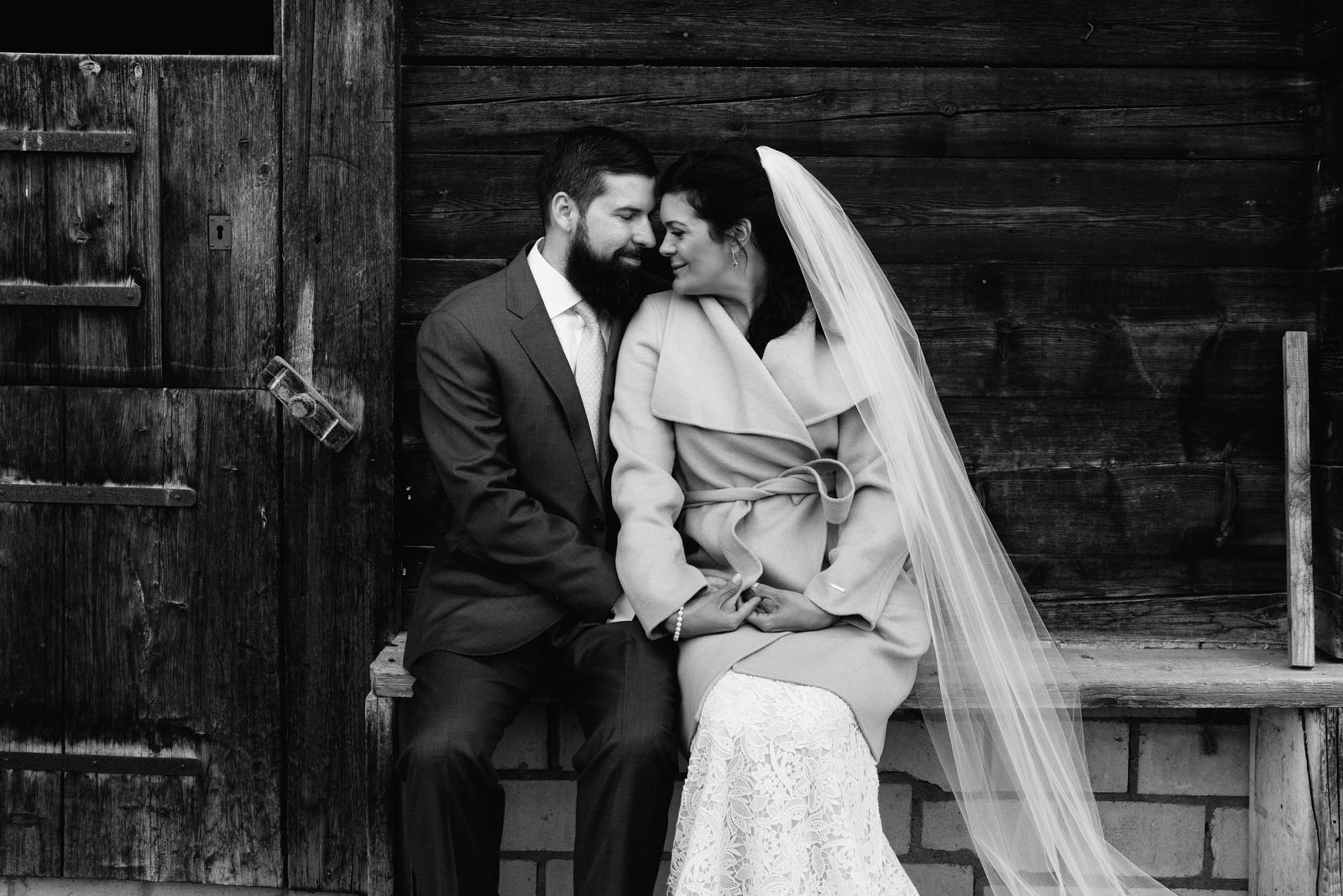couple in front of a chalet in the mountains Switzerland Elopement