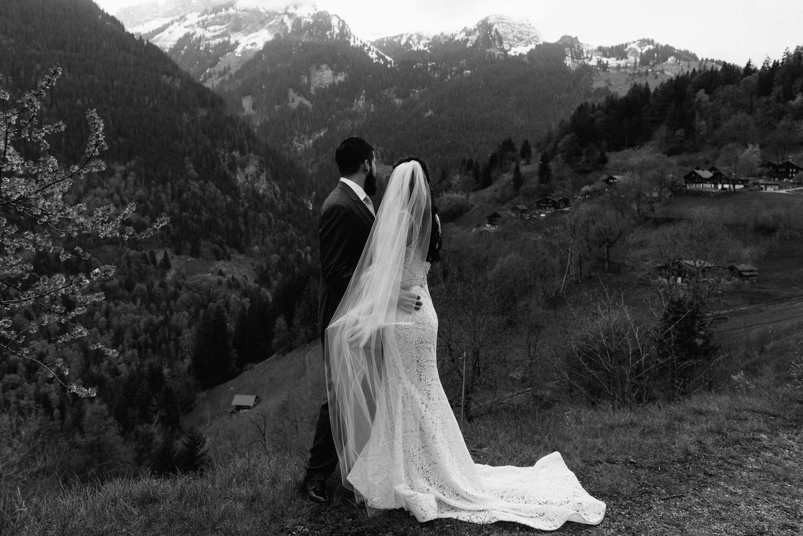 Switzerland mountain elopement couple looking out over the mountains